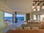 Open plan, living room with dining area and sea vistas!
