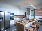 Fully equipped kitchen with direct access to the pool terrace and BBQ area!