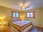 When you're ready to retire for the evening, the master bedroom offers a comfortable king-sized bed for you to fall...