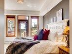 Snowbird 304 Master bedroom looking toward deck with door to hot