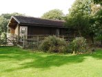 Games Lodge - table tennis, pool table and library area with patio doors onto decking.