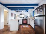 The kitchen is located between between the living and dining areas