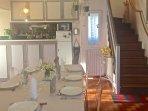 Séjour -coin cuisine avec belle vue sur le vallon de Prouilhe