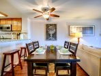 Dining with 4 chairs plus a bench, 2 bar stools to sit at the breakfast bar, high chair is available