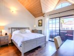 A Bright and Airy Master Bedroom with a Comfortable Queen Bed