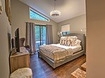 This master bedroom features a queen bed, beautiful furnishings, access to the deck, and a flat-screen Smart TV.