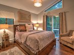 The second bedroom also features a queen bed, stylish decor, and access to the private deck.
