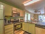 Modern stainless steel appliances make cooking in this kitchen a real treat.