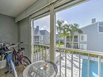 Enjoy your morning coffee with a cool breeze on this charming balcony overlooking the pool.