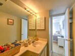 This private en suite bathroom includes a walk-in shower.