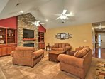 Equipped with comfortable sofas, a large flat-screen cable TV and gas burning fireplace, this inviting living area will...
