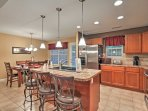 The kitchen comes complete with stainless steel appliances and an abundance of counter space.