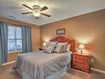 The second bedroom features a cozy full-sized bed and elegant decor.