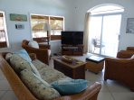 Living room - enjoy the ocean view or the 50' flatscreen tv, both are great!