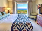 The first master bedroom features a sumptuous king-size bed