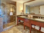 First master bath has a double granite vanity with a glass and marble shower