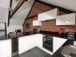 Fully equipped modern kitchen, even with wine cooler for those that are interested!