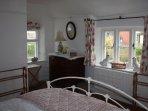 Pretty double aspect bedroom
