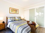 Privacy sliding doors separate bedroom from living