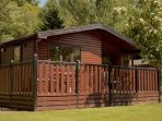 Caol Gleann is a luxurious three bedroomed chalet on the eastern shores of Loch Lomond.