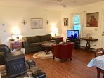 Living room with DISH TV/DVD, games, queen sleep sofa. Electric heat with wood stove backup.
