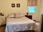 Master bedroom with queen bed, ceiling fan, separately-controlled  DISH TV reception, clock/radio.