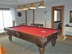 Bottom floor pool table looking toward twin bedroom
