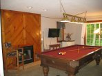 Downstairs pool table and television
