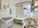 Claw foot tub with shower. Blow dryer included