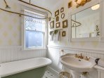 Looks like a Victorian bathroom and functions like a modern bathroom.
