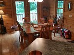 Dining room table expands to seat 8. French doors open onto the Sun Deck.