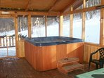 Six person hot tub is on a private screened-in covered porch