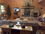 Great Room/living room with wood burning fireplace and hi-def satellite TV