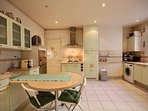 Kitchen is equipped with : breakfast table for 4 people, fridge, freezer, dishwasher, gas burner, ex