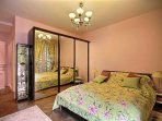 Bedroom 1is equipped with : double bed (1.40m), 2 bedside tables, chest of drawers, wardrobe, hard w
