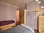 Bedroom 2  is equipped with : 2 single beds, bedside table, chest of drawers, wardrobe, hard wood fl