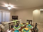 Gather around this charming dining table to enjoy your meals.