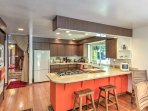 Prepare home-cooked meals in the well-stocked, fully equipped kitchen.