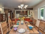 Six guests can gather for meals at the dining room table.