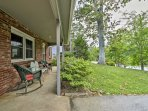 Enjoy your time on the front porch of this 3-bedroom, 1.5-bathroom vacation rental house in Arden!
