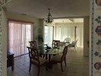 View of one dining area, looking into sun room