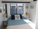 The master bedroom. A comfortable queen size bed.Incredible views from the window and back deck