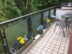 BALCONY with modern outdoor table and chairs.