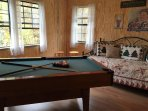 Open loft with pool table and daybed.