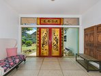 Original Chinese painted entry doors grace the foyer