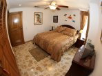 Second bedroom with queen size bed, fan and individual AC