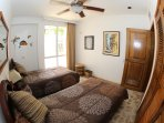 Third bedroom with two single beds, fan and individual AC