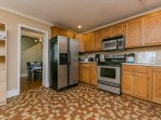 Kitchen with dishwasher, electric stove/oven, microwave, and ref