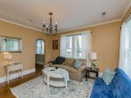 Enter into the living room with hardwood floors flowing througho