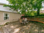 Sit and relax under this beautiful shaded oak tree on this large